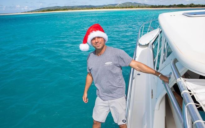 Kenny Chesney on a boat with Santa Hat