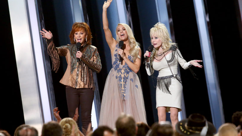 Carrie Underwood, Reba, and Dolly Parton all singing on stage