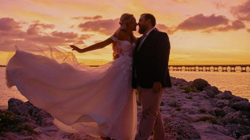 Luke combs and wife at the beach for their wedding