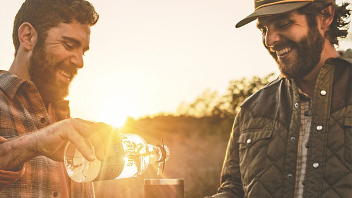 Thomas Rhett and his cousin pouring a tequila bottle