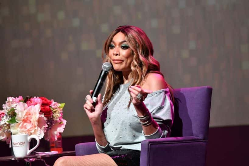 Wendy Williams sitting in a purple chair