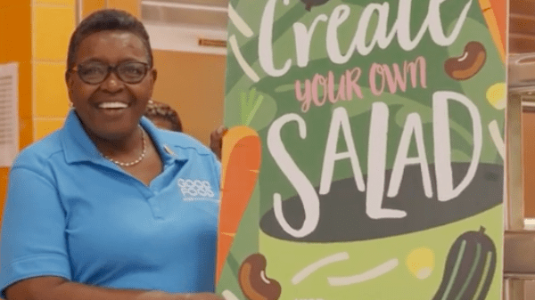 Betti Wiggins holding a create your own salad sign