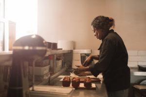 black woman baking