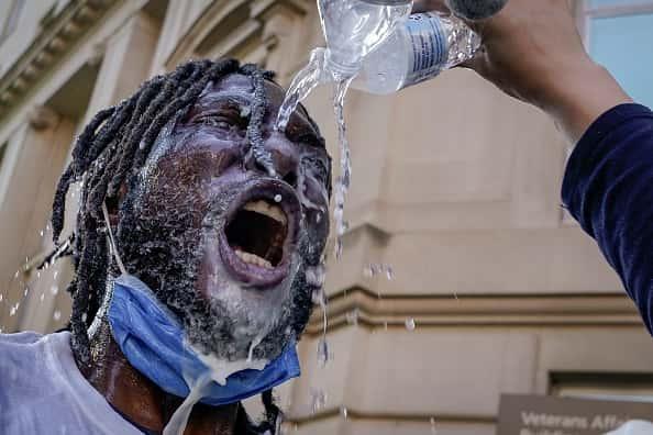 man gets pepper spray on face