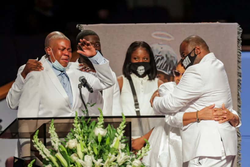 George Floyd's family wearing white and crying while at his funeral