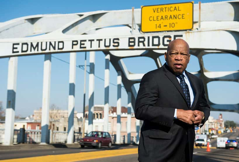 """UNITED STATES - FEBRUARY 14: Rep. John Lewis, D-Ga., stands on the Edmund Pettus Bridge in Selma, Ala., in between television interviews on Feb. 14, 2015. Rep. Lewis was beaten by police on the bridge on """"Bloody Sunday"""" 50 years ago on March 7, 1965, during an attempted march for voting rights from Selma to Montgomery."""