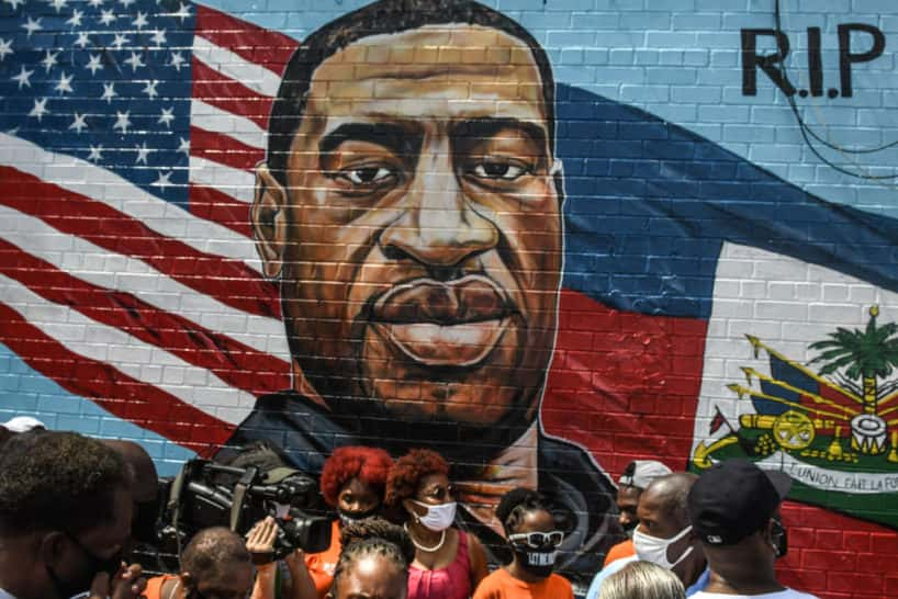 NEW YORK, NY - JULY 13: A mural painted by artist Kenny Altidor depicting George Floyd is unveiled on a sidewall of CTown Supermarket on July 13, 2020 in the Brooklyn borough New York City. George Floyd was killed by a white police officer in Minneapolis and his death has sparked a national reckoning about race and policing in the United States.
