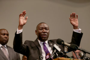 ST LOUIS, MO - AUGUST 18: The family attorney for Michael Brown, Benjamin Crump, raises his hands and speaks during a press conference where Michael Baden, a medical examiner who carried out an autopsy of the 18 year old teenager announced his findings at the Greater St. Marks Family Church on August 18, 2014 in Ferguson, Missouri. Unarmed teenager Michael Brown was shot and killed by a Ferguson police officer on August 9th.