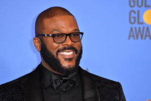 Tyler Perry smiling at the camera