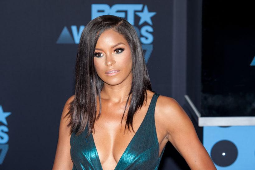 Claudia Jordan wearing green dress