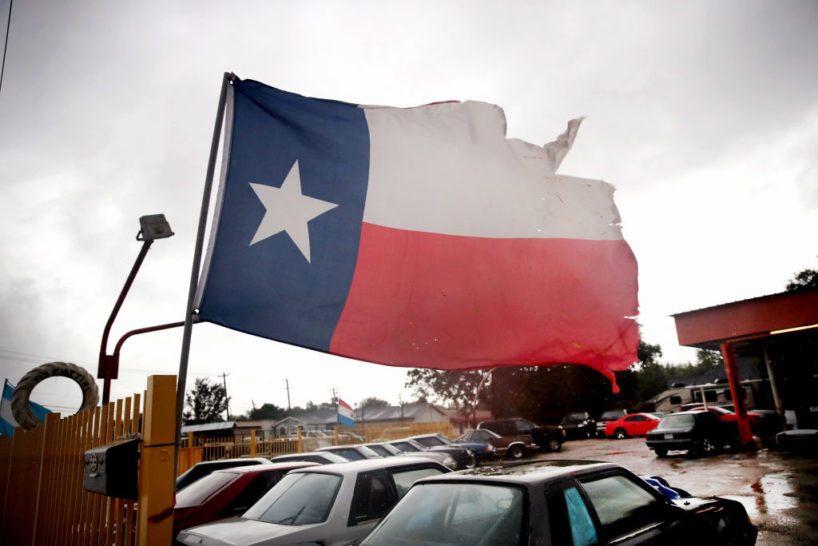 HOUSTON, TX - AUGUST 26: Wind from Hurricane Harvey batters a Texas flag on August 26, 2017 in Houston, Texas. Harvey, which made landfall north of Corpus Christi late last night, is expected to dump upwards to 40 inches of rain in Texas over the next couple of days.
