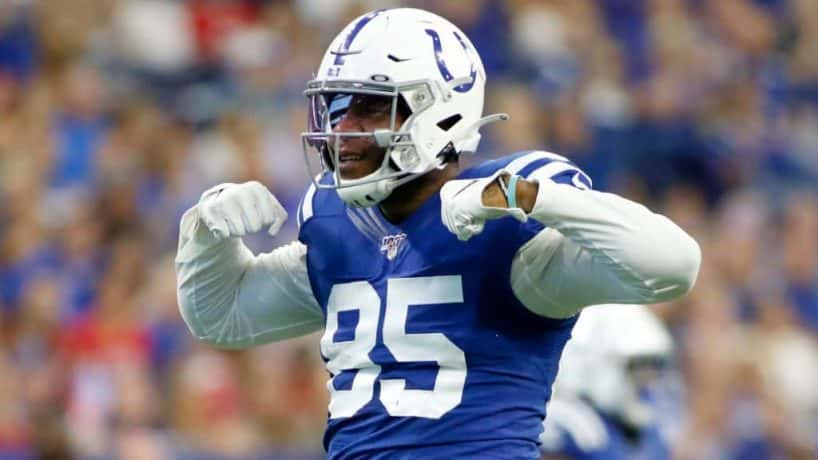 Colts tight end Eric Ebron flexes after a catch during a 2019 home game.