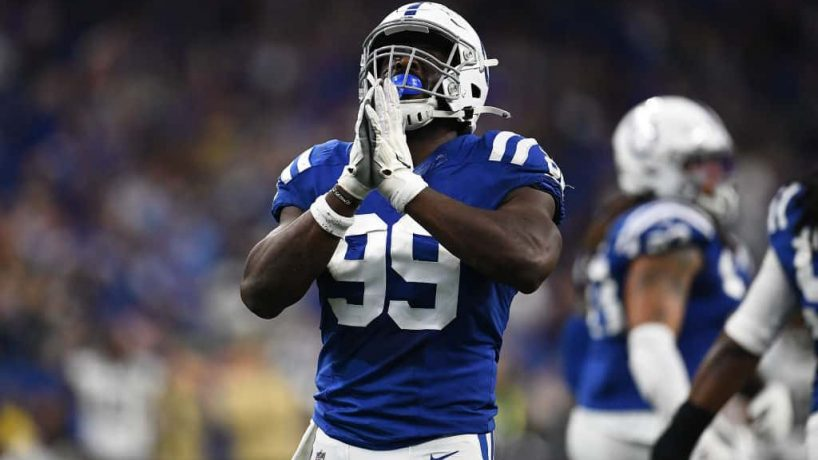 Colts defensive end Justin Houston reacts after a sack during the 2019 season.