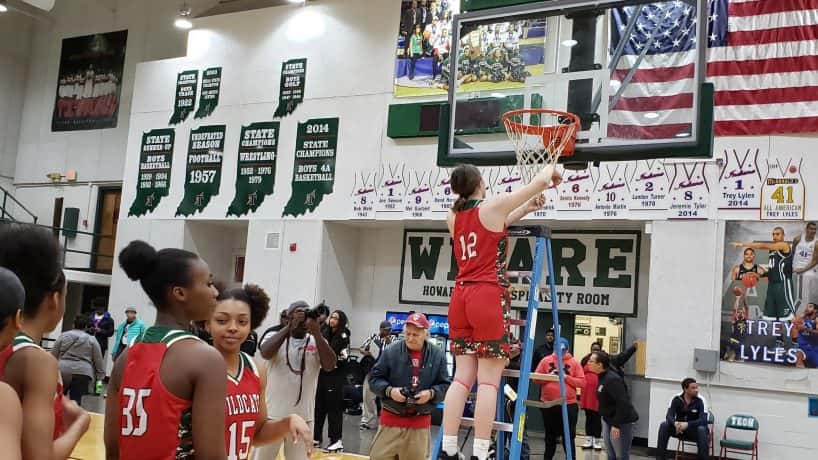 Katie Davidson cuts down the nets after taking down North Central, 61-58, in the Sectional 10 title game.