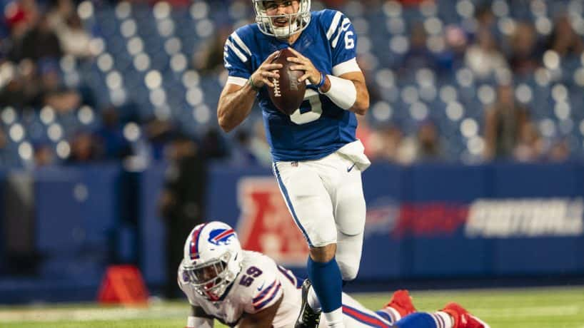 : Indianapolis Colts Quarterback Chad Kelly (6) rolls out and looks to pass the ball avoiding Buffalo Bills