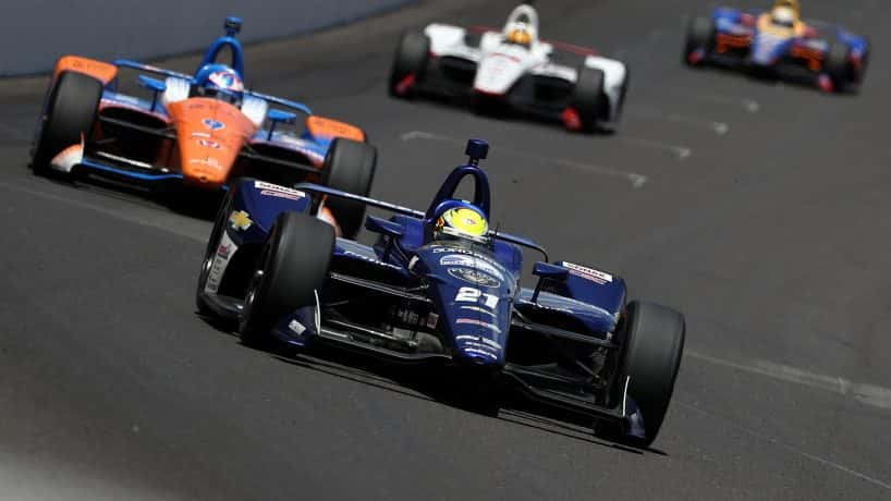 Spencer Pigot, driver of the #21 Preferred Freezer Service Chevrolet, races during the 102nd Indianapolis 500