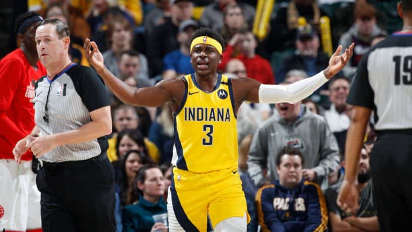 Aaron Holiday #3 of the Indiana Pacers reacts after being called for a foul against the Toronto Raptors