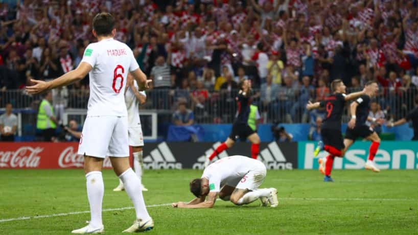 England's John Stones reacts after Croatia's Mario Mandzukic scores his side's second goal of the game during extra time.