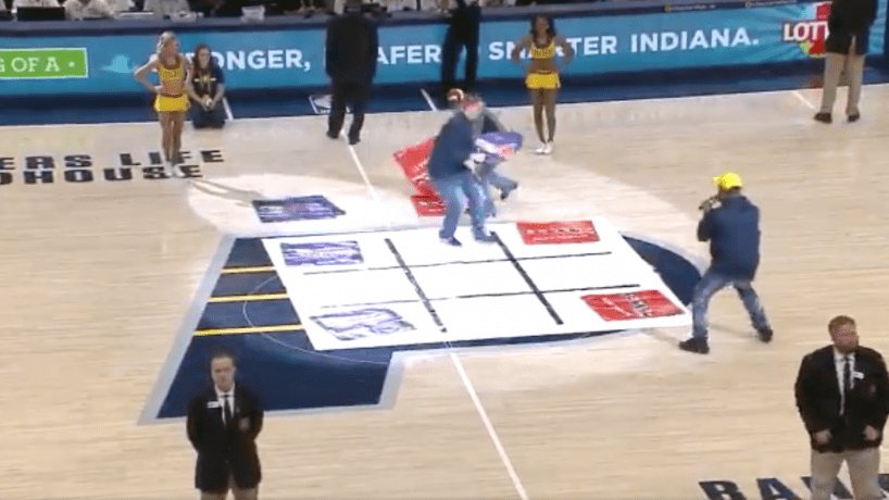 Two Indiana Pacers fans playing lifesize tic-tac-toe at a Pacers game at Bankers Life Fieldhouse on December 12, 2018.
