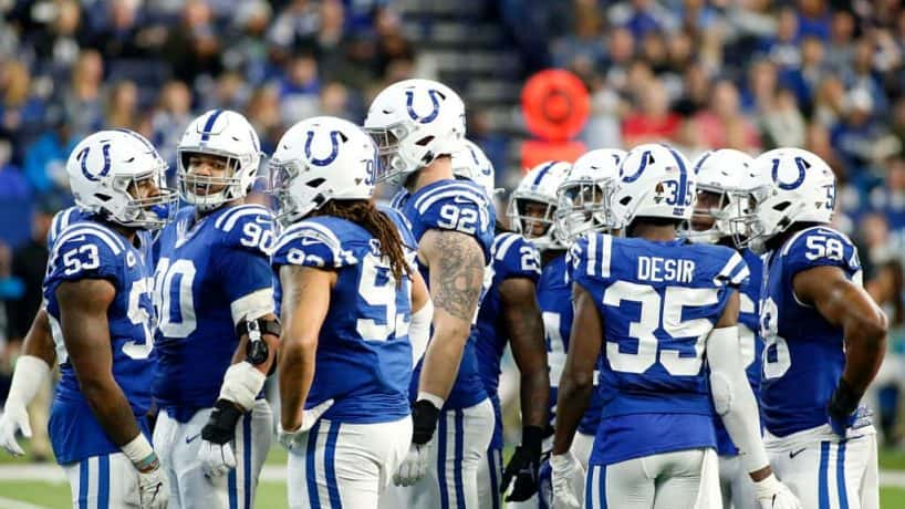 The Colts defense huddles up before a 2019 play at Lucas Oil Stadium.