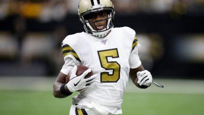 Teddy Bridgewater #5 of the New Orleans Saints runs the ball against the Dallas Cowboys