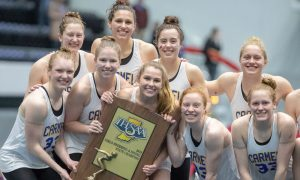 Carmel Swimming and Diving team with State Championship trophy