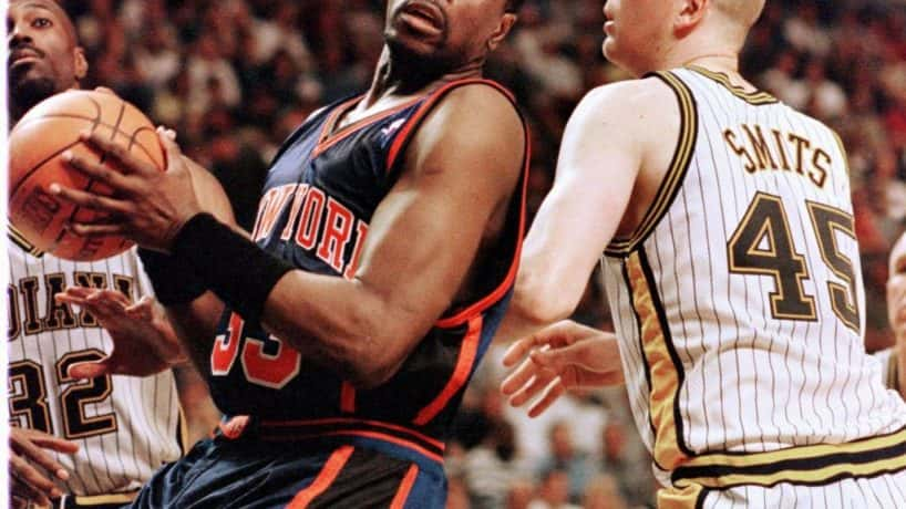 Patrick Ewing (L) of the New York Knicks works into position against Rik Smits (R) of the Indiana Pacers 07 May