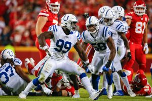 Colts defensive end Justin Houston reacts after a sack in 2019