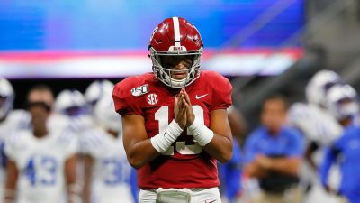 Tua Tagovailoa #13 of the Alabama Crimson Tide reacts after passing for a touchdown in the second half against the Duke Blue Devils at Mercedes-Benz Stadium