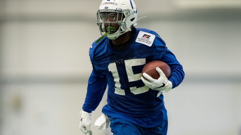 Indianapolis Colts wide receiver Parris Campbell (15) runs through a drill during the Indianapolis Colts rookie camp