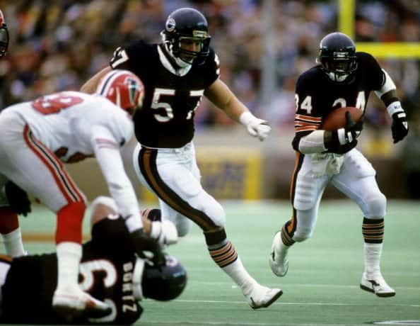 Chicago Bears Hall of Fame running back Walter Payton (34) follows guard Tom Thayer (57) November 24, 1985, at Soldier Field