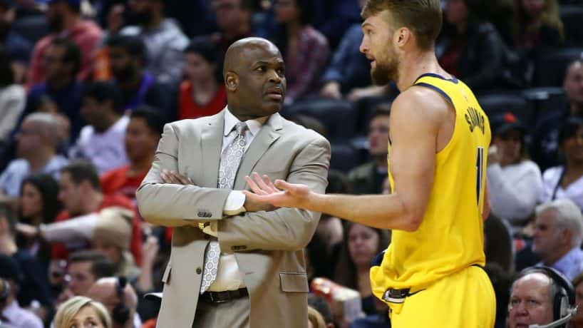Pacers head coach Nate McMillan and forward Domantas Sabonis talk during a 2020 road loss.