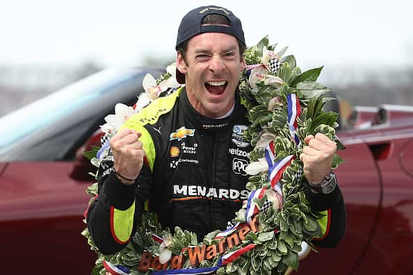Simon Pagenaud of France, driver of the #22 Menards celebrates after winning the 103rd running of the Indy 500.