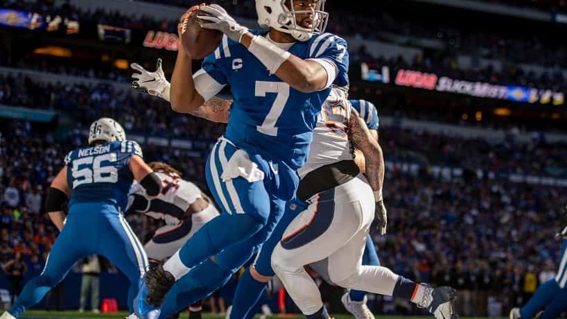 Colts quarterback Jacoby Brissett escapes Denver Broncos Von Miller at Lucas Oil Stadium.
