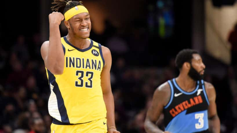 Pacers center Myles Turner reacts after making a three-pointer against the Cavs in 2020.