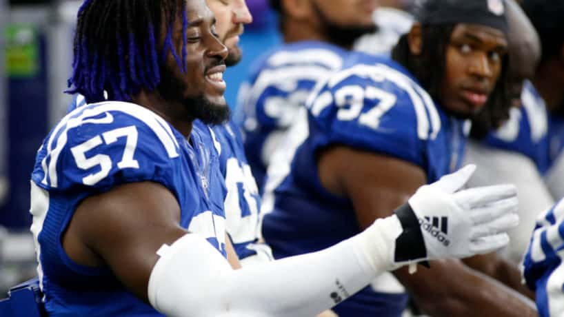 Colts defensive end Kemoko Turay talks on the bench during a 2019 home game.