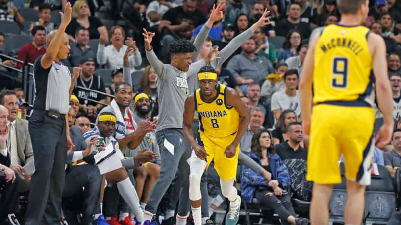 Pacers guard Justin Holiday runs back on defense after hitting a three-pointer.