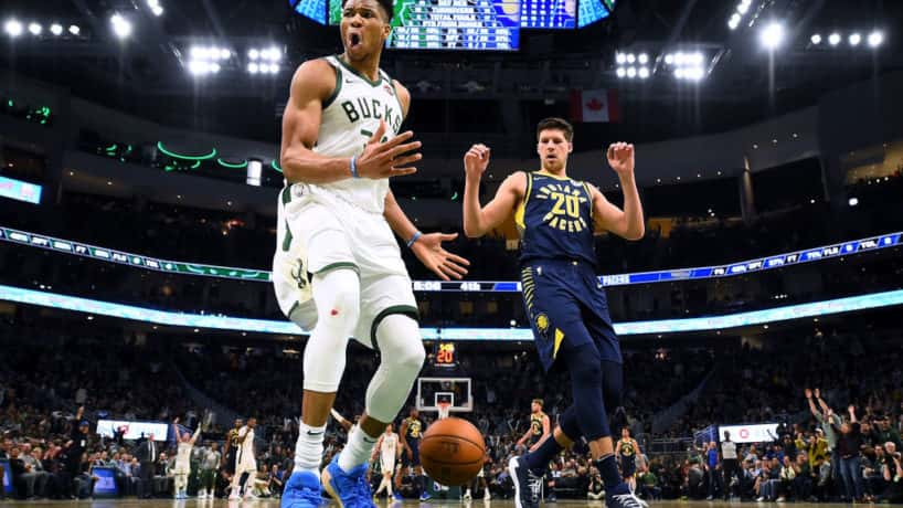 Bucks forward Giannis Antetokounmpo finishes off a dunk attempt in a 2020 game.