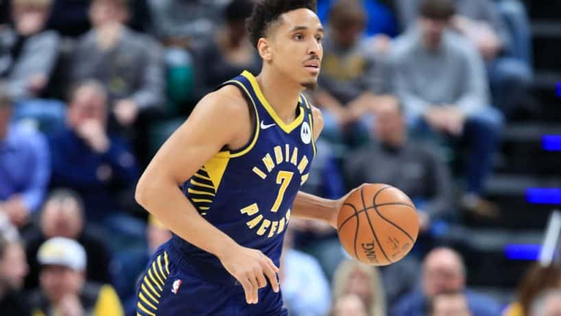 Pacers guard Malcolm Brogdon looks to pass in a 2019 game at Bankers Life Fieldhouse.