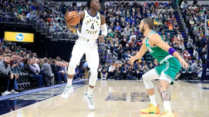 Pacers guard Victor Oladipo dibbles in a 2020 game against the Celtics.