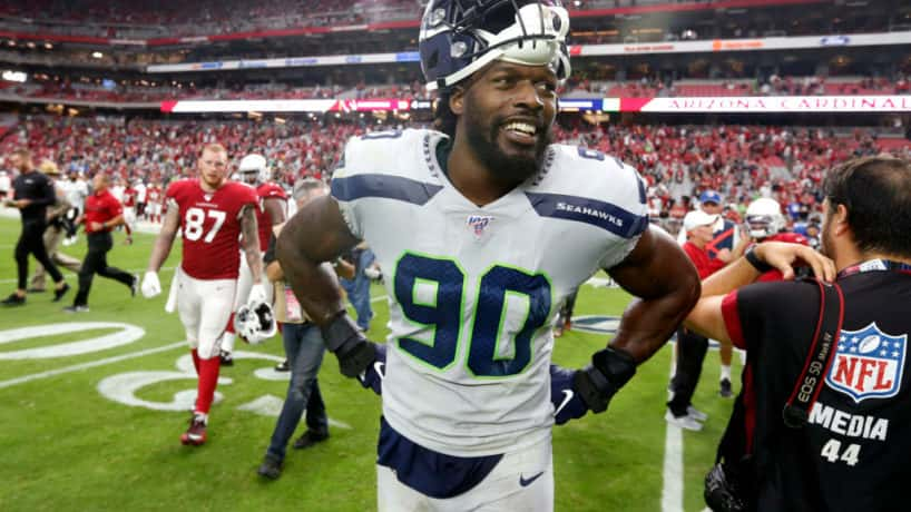 Seattle defensive lineman Jadeveon Clowney reacts after a 2019 game.