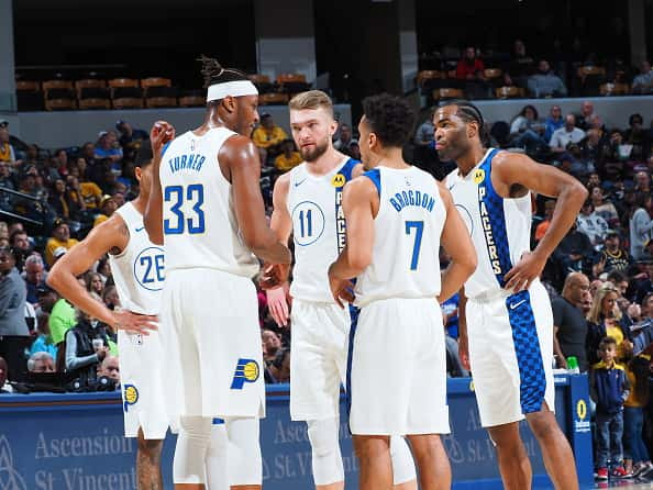 The Pacers gather for a team huddle before a 2020 game.
