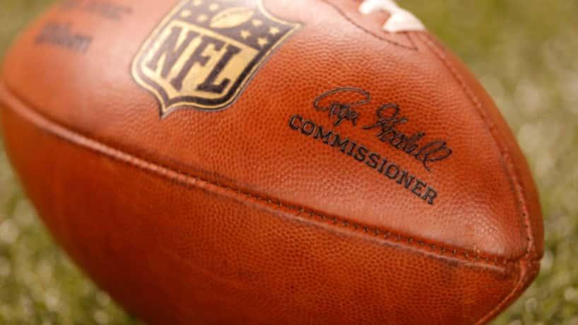 NFL football lies on the field.