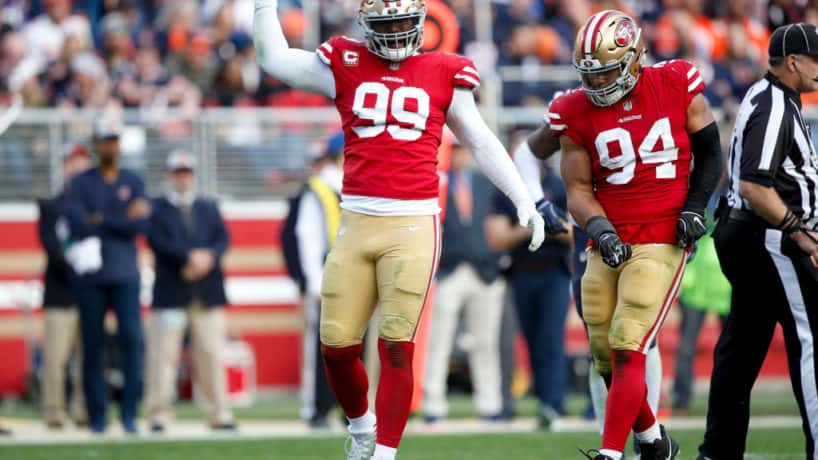 49ers defensive end DeForest Bucker reacts after a 2019 sack.