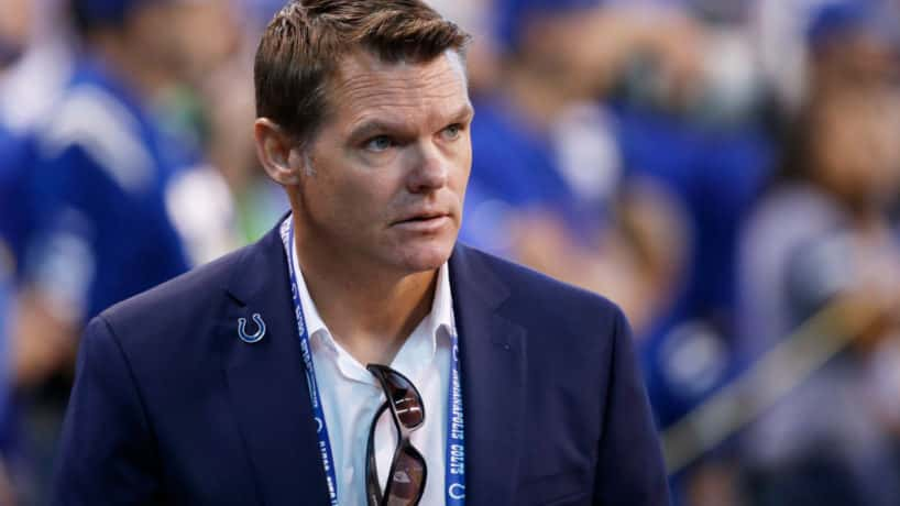 Colts general manager Chris Ballard walks on the sideline before a home game.