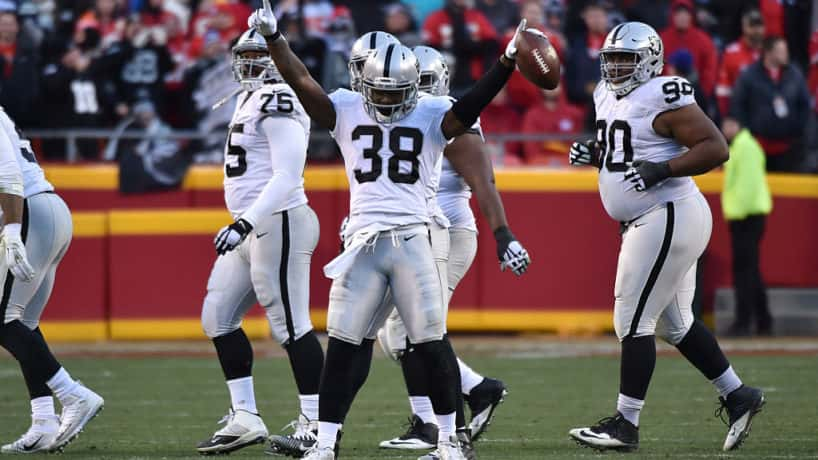 Former Raiders cornerback T.J. Carrie celebrates after a big play.