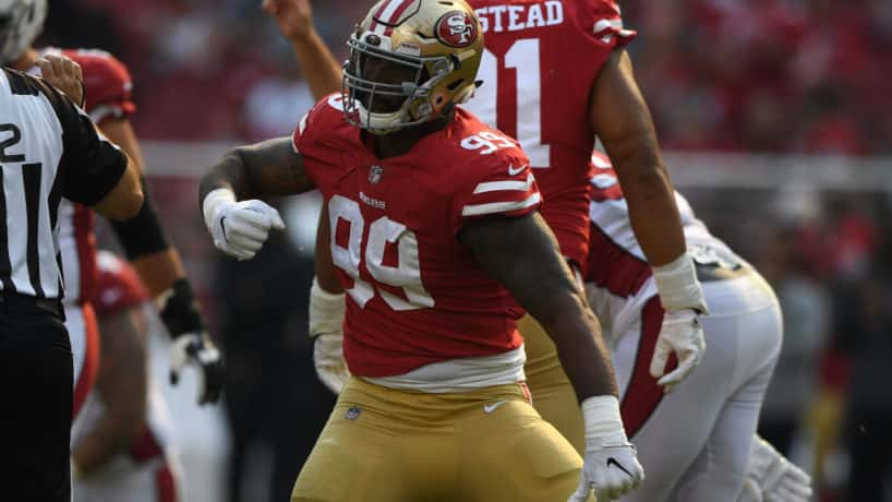Former 49ers defensive lineman DeForest Buckner reacts after a big play.