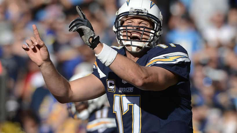 Former Chargers quarterback Philip Rivers motions at the line of scrimmage.