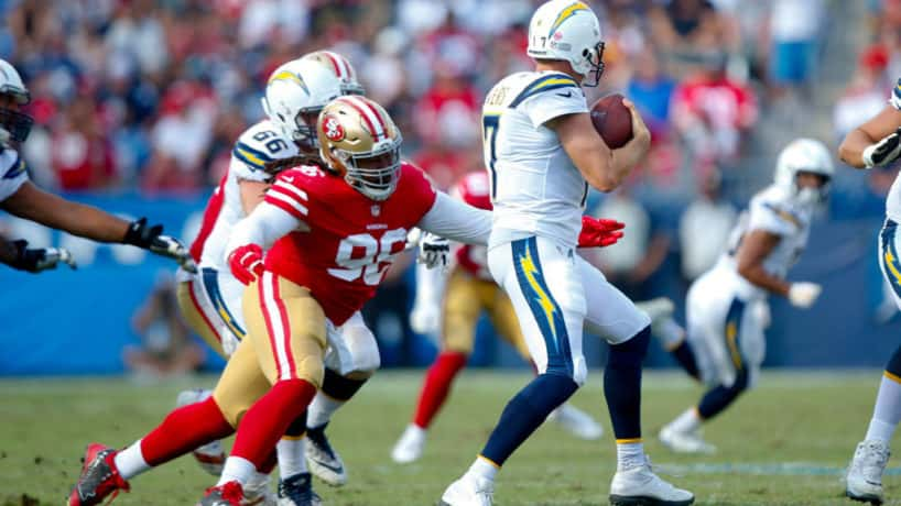 Former 49ers defensive lineman Sheldon Day gets ready to tackle Philip Rivers.