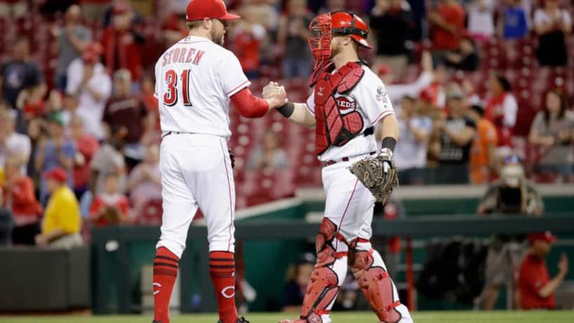Drew Storen and Tucker Barnhart shake hands after Reds game